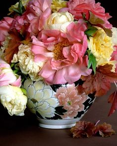 "A Perfect Match  This Japanese bowl was given to Martha many years ago. ""When I received it, I had never seen a yellow, peach, or mauve tree peony, but obviously the painter of the bowl had,"" says Martha. ""Finally my tree peonies matured and now provide blooms of almost the same colors."""