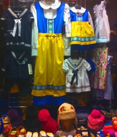 Traditional Swedish children's clothing hangs in store window in Old Town Stockholm, Sweden. —Paula Ann