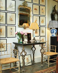 Robert Kime Christie's catalog...I love the arrangement of prints on the wall, and the number of them, too.