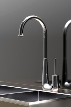 The latest addition to the ISMA line of fixtures is the elegant Swan faucet. Its proportions subtly combine heavy and light elements that maintain balance between Kitchen Mixer, Kitchen And Bath, Kitchen Faucets, Silver Swan, Heavy And Light, Water Faucet, Bath And Beyond, Toilet Design, Form Design