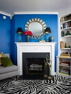 Blue walls, white fireplace, BW floor