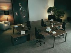 Office & Workspace:Luxurious Advocates And Executives Workspace Room With Brown Wood Work Desk With Black Swivel Arm Chairs With Light Brown Sofa And Black Stand Lamp Huge Painting For Show Big Companies With Green Vegetable And Floor Lighting Virtuosity Henrique Steyer: Fantastic Contemporary Workspace designs