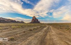 A Shiprock Road by Aric-Jaye  cloudy dirt road new mexico plume shiprock volcanic A Shiprock Road Aric-Jaye