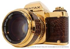 """It was March 16th, 1981, one year after the introduction of the Pentax LX. The ten-millionth Pentax SLR camera, an LX, came out of AOC's main plant in Mashiko and was given to the chief designer, then chairman of Asahi Opt. Co. Ltd. Minoru Suzuki. In order to celebrate this 10 million event, on August 25th, 1981 a limited edition """"LX Gold"""" was introduced."""