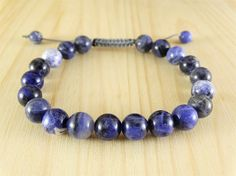 This bracelet made with only natural sodalite stones. To make the bracelet I used high quality wax cord, comfortable to put on and take off, don't be afraid to break up #bluebracelet #sodalite #beadsbracelet