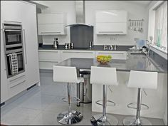 High gloss white kitchen with Grey counter tops                                                                                                                                                                                 More