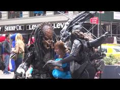 Times Square Circus of Aliens & Predators, Minnie & Mickey, Hello Kitty,...
