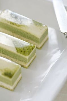Green Tea and Jasmine Delice - pistachio cake with a jasmine/white chocolate mousse, and a matcha/white chocolate mousse. Serve with a Seville Orange Sorbet, and you have on e beautiful and delicious dessert. Matcha Dessert, Matcha Cake, Pistachio Cake, Green Tea Dessert, Green Tea Recipes, Sweet Recipes, Cake Recipes, Dessert Recipes, Patisserie Fine