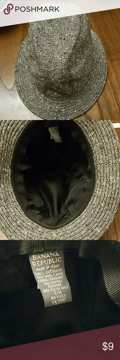 Banana Republic Women's Wool Tweed Fedora Hat S/M Made in Italy.  Exterior in nice condition.  Interior lining has some small white spots where it has been bleached by hair products.   I have tried several spot removers to no avail.   See photos for actual condition.   Shell is 100% wool; lini g 100% rayon.  Dry clean only. Banana Republic Accessories Hats