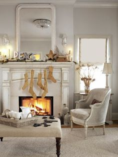 Design Chic: Christmas Mantles. Love those rustic wooden stockings!