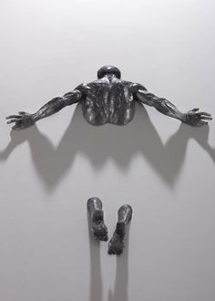 Figurative Sculptures Embedded in Gallery Walls by Matteo Pugliese sculpture
