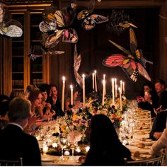 """For this outrageous and feminine dinner party Rebecca decorated withferns andpersimmons which """"grew"""" out of a mound of dirt on thetable. The table was set with Marchesa china by Lenox.Handpainted butterflies dance over table. Photoby Hannah Thompson.         - TownandCountryMag.com"""
