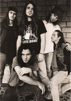Early nineties shot of Pearl Jam - with that carpet it looks like it must have been taken in the lobby of some airport lounge! Featuring Jeff Ament, Stone Gossard, Mike McCready, Eddie Vedder and Dave Abbruzzese