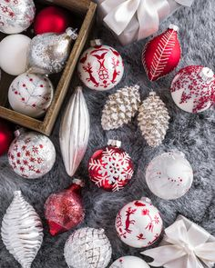 Hand-painted Nordic Frost Ornament Set feature delicate hues of white, red, and silver complemented by hand-applied beading and glitter accents.