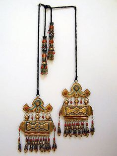 Uzbek tassels koran boxes, Central Asian (Very beautiful pair of chapani ornaments with heavy fire gilding and inlaid turquioise.)