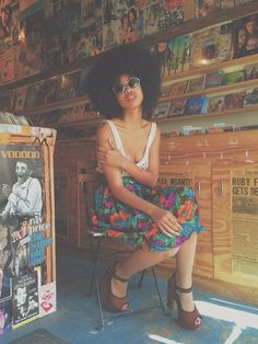 Wearing natural hair in record store w/ print skirt, white tank and leather heels // Precious Henshaw's Blog