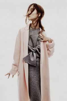 pink coat. grey under layers.