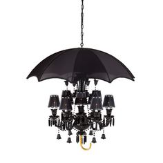 Rainy days won't dampen your mood when you have this darkly elegant pendant light hanging in your home. Sleek black crystals add a touch of Gothic refinement.