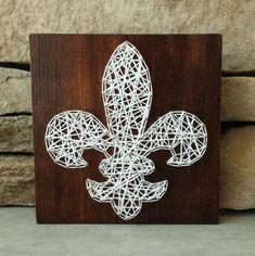 Fleur de lis string art on wood board