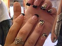 Black french-yellow flowers nails