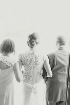 The bride's mother and father prepare to walk her down the aisle. | Photo by Glass Jar Photography