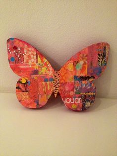 Butterfly decoration I made by buying a plane wooden butterfly template and sticking on small individual pieces of paper :)