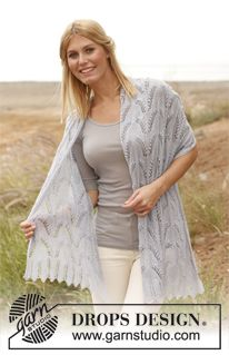 """Knitted DROPS shawl with lace pattern and bobbles in """"Lace"""". ~ DROPS Design free"""