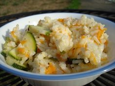Zucchini Rice Pilaf from Food.com:   								Adapted from Quick Cooking Dec 2001 recipe.  A very pretty side dish that goes well with a variety of meats.