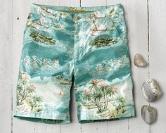 Step into island mode. These men's retro-fit, vintage-washed cotton poplin shorts with their bright tropical print will make a splash whether you're headed to the tropics or a backyard barbecue.