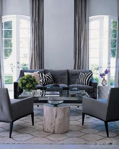 My Living Room! Elle Decor: Monique Lhuillier - modern, gray sofa and chairs, gray silk drapes, zebra pillows, . Grey Room, Living Room Grey, Home And Living, Living Room Decor, Modern Living, Modern Wall, Bedroom Decor, Elle Decor, Sofa Living