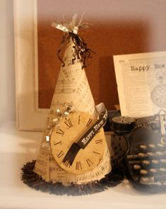 hat, try it with modge podge?  old sheet music or books on hat w/Garland and clock embellishment (stamped or printed)