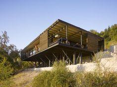 elevated house suspended on wood pillars