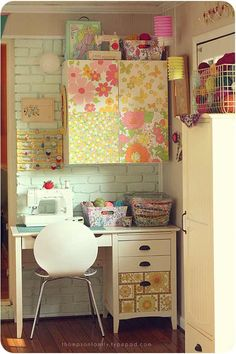 you can have a functional sewing space ANYWHERE! Love the vintage barbie case on top of the cupboard.