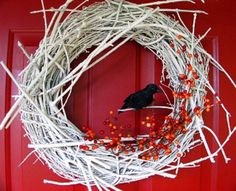 Love it...you could do this for any holiday by simply changing the decorations....I love the white, it would stand out on my front door.