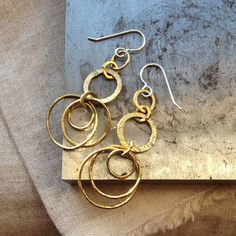 Five Gold Rings, a simple pair of brass chain earrings, coming to Leaves of Glass this week.