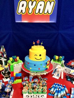 Awesome dessert table and cake at a Lego Movie birthday party! See more party planning ideas at CatchMyParty.com!