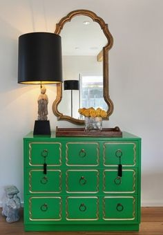 kelly green Dorothy Draper Chest, gold mirror, Chinese, figurine lamp with black shade and wood tray.