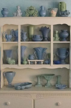 I display my old pottery collection on an upcycled hutch top in the living room. www.retrofitstyle.com/blog