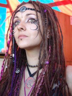 I hate facial tattoos, but this look overall is kind of cool, for certain contexts at least.