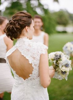 chignon, but not sure how a veil could be incorporated