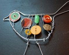 Make wire art with buttons. Fun idea for kids.