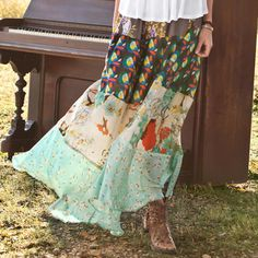 For lawn parties or candlelit evenings, our sweeping silk skirt is tiered in four scarf prints, with wide elasticized waist.