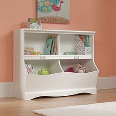 This soft white bookcase from Sauder Woodworking doubles as a footboard for any twin sized bed. Its cubbyhole storage is perfect for bins, books, toys, etc.   American–made and environmentally conscious, all Sauder® products are manufactured with engineered wood — a composite of high–quality trimmings and post–milling leftovers. To further that go–getting greenness, we convert residual sawdust into electricity with our very own cogeneration plant. And any remaining wood waste provides a…