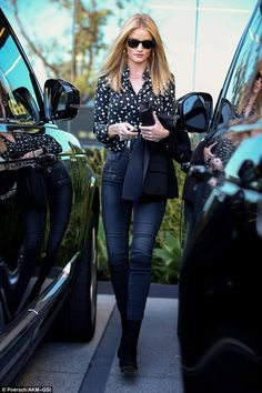 Star spangled:Rosie Huntington-Whiteley naturally showed off her incredible flare for fashion in a chic moon and star print shirt during an outing in Beverly Hills on Tuesday