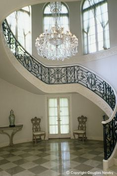 It's all in the details.......floors, marble slabs and iron stair rails - The Enchanted Home