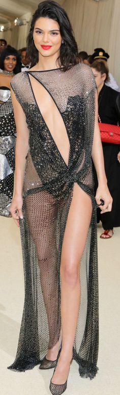 Kendall Jenner in Dress – La Perla Haute CoutureShoes – Christian LouboutinPurse – TomasiniEarrings – Lorraine SchwartzRings – Ofira