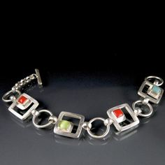 Made from 100 percent recycled sterling silver and glass cabochon this bracelet was inspired by Taliesin West and features a toggle clasp, shown with cherry, co