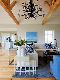 This living room by Sarah Richardson Design emphasizes the East Coast saltbox home's sea-inspired blue and white palette. A soaring ceiling accommodates the two-tiered wrought-iron chandelier, which s Cottage Living Rooms, Coastal Living Rooms, Home And Living, Living Room Decor, Coastal Homes, Coastal Cottage, Coastal Country, Modern Living, White Cottage