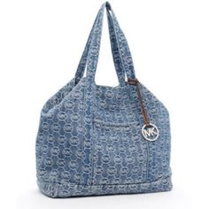 Authentic Michael Kors Monogram Large Denim Tote 100% authentic. Sold out online and hard to find! • Perfect for school or being on the go! • Extra large sized bag • 22.5 inches across x 13.5 inches tall x 8.75 inches width across the bottom x 11 inch strap drop • Extra spacious • NO TRADES • Michael Kors Bags Totes
