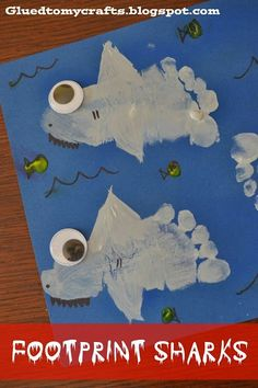 In honor of Shark Week, we made Footprint Sharks. No animals or children were harmed in the making. Not even a drop of blood!  These sharks are sure to steal the show on your refrigerator!